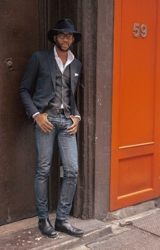 How To Wear Blue Jeans With Black Leather Boots For Men: A charcoal blazer and blue jeans are the ideal way to introduce some class into your day-to-day rotation. This look is finished off wonderfully with a pair of black leather boots.