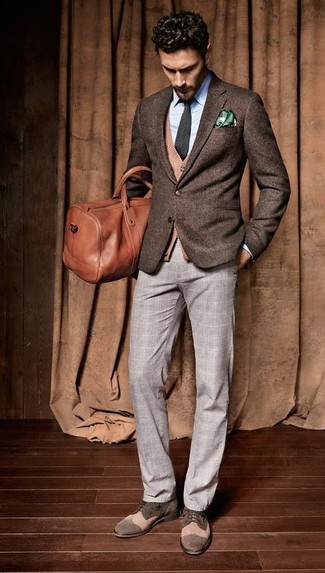 A dark brown wool suit jacket and grey tartan dress pants will showcase your sartorial self. Mix things up by wearing brown suede derby shoes.