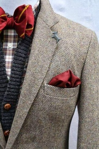 Pairing a brown wool suit jacket with an oxblood pocket square is an on-point option for a day in the office. This outfit is ideal for in-between weather.