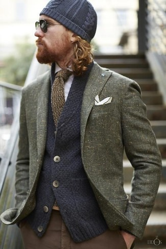 How to wear: olive wool blazer, navy knit cardigan, white long sleeve shirt, brown chinos