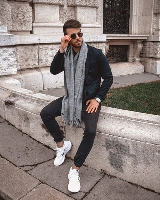 How to Wear a Grey Scarf For Men: This casual pairing of a navy blazer and a grey scarf is extremely versatile and really apt for whatever the day throws at you. The whole ensemble comes together wonderfully when you complement your look with a pair of white athletic shoes.