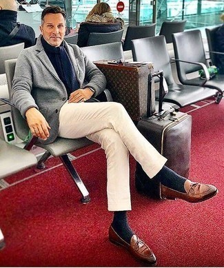 How to Wear Brown Leather Loafers For Men: Go for something casually classic and contemporary in a grey wool blazer and white chinos. A trendy pair of brown leather loafers is an easy way to transform this look.