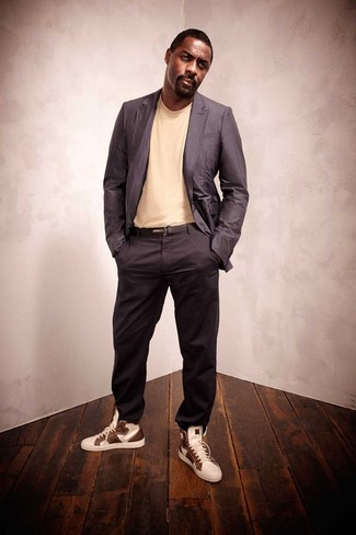 White and Brown High Top Sneakers Outfits For Men: Wear a charcoal blazer with charcoal chinos if you wish to look stylish without exerting much effort. A trendy pair of white and brown high top sneakers is an effective way to infuse a dash of stylish casualness into this getup.