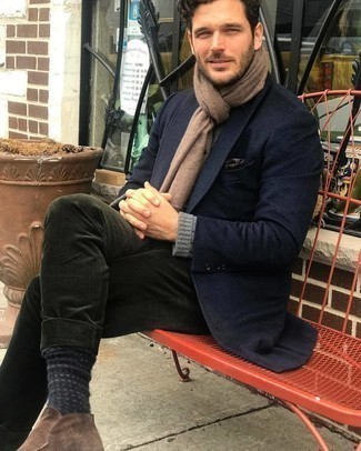 Grey Crew-neck Sweater Outfits For Men: Up your casual look in a grey crew-neck sweater and dark green corduroy chinos. This ensemble is completed wonderfully with brown suede desert boots.