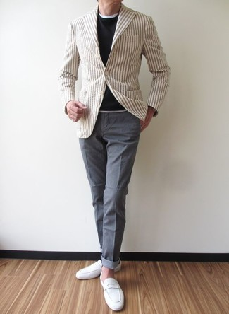 How to Wear a Beige Vertical Striped Blazer For Men: This combo of a beige vertical striped blazer and grey chinos crosses the divide between classic and relaxed casual. Take this look in a more sophisticated direction by rounding off with white suede loafers.