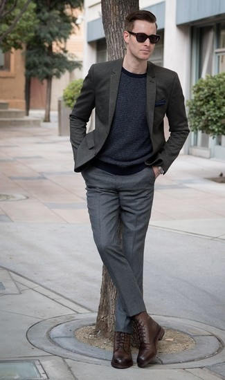How to Wear a Dark Green Blazer For Men: You're looking at the undeniable proof that a dark green blazer and grey dress pants are awesome when married together in an elegant outfit for a modern man. A pair of brown leather casual boots effortlessly revs up the style factor of this look.