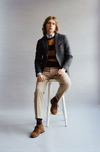 Brown Suede Desert Boots Outfits: Putting together a charcoal wool blazer and khaki dress pants is a surefire way to infuse your closet with some manly elegance. For a more casual spin, introduce a pair of brown suede desert boots to the equation.