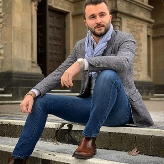 Grey Blazer with Blue Jeans Chill Weather Outfits For Men: This pairing of a grey blazer and blue jeans is extremely easy to recreate and so comfortable to rock throughout the day as well! Want to go all out on the shoe front? Add brown leather chelsea boots to the mix.