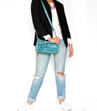 If you're in search of a casual yet chic ensemble, wear a black blazer with light blue ripped jeans. Both garments are totally comfy and will look fabulous together. When it comes to shoes, this look is complemented nicely with white low top sneakers.