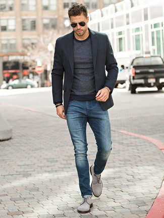 Fashion for 30 Year Old Men: What To Wear: A black blazer and navy jeans are essential in any guy's functional closet. Put a different spin on an otherwise mostly dressed-down ensemble by finishing off with grey suede derby shoes.