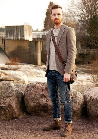 Beige Crew-neck Sweater Outfits For Men: Extremely stylish and practical, this casual combo of a beige crew-neck sweater and navy jeans provides with wonderful styling possibilities. Add a pair of brown suede casual boots to the mix for an instant dressy look.