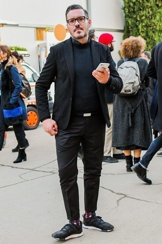 How to Wear a Black Blazer For Men: A black blazer and black chinos worn together are a smart match. For something more on the daring side to complete this ensemble, complete your ensemble with a pair of black athletic shoes.