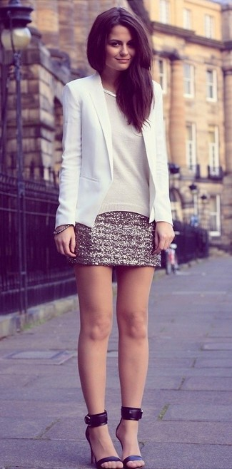 Stand out among other stylish civilians in a beige crew-neck sweater and a gold sequin mini skirt. Polish off the ensemble with black leather heeled sandals.