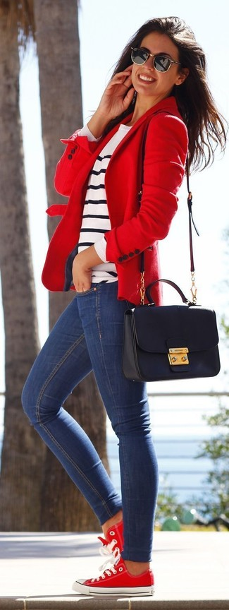 Consider wearing a white striped crew-neck sweater and blue slim jeans for a comfortable outfit that's also put together nicely. Go for a pair of red and white low top sneakers for a more relaxed feel.
