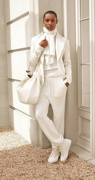 A white crew-neck sweater and white sweatpants are a perfect pairing to be utilised at the weekend. A pair of white canvas high top sneakers brings the dressed-down touch to the outfit. When spring is in full effect, you'll appreciate how perfect this getup is for transitional weather.