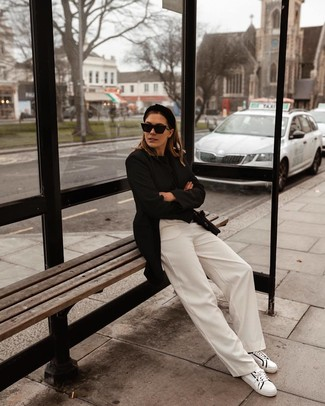 How to wear: black blazer, black crew-neck sweater, white wide leg pants, white and black leather low top sneakers