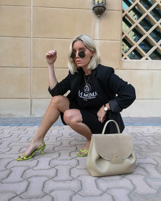 How to wear: black blazer, black and white print crew-neck t-shirt, black bike shorts, green-yellow leather heeled sandals