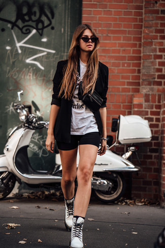 How to wear: black blazer, white and black print crew-neck t-shirt, black bike shorts, white leather lace-up flat boots