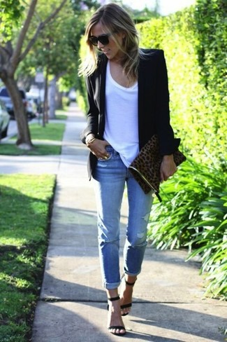 Effortlessly blurring the line between chic and casual, this combination of a black blazer jacket and baby blue distressed boyfriend jeans is likely to become one of your favorites. For footwear go down the classic route with black suede heeled sandals.
