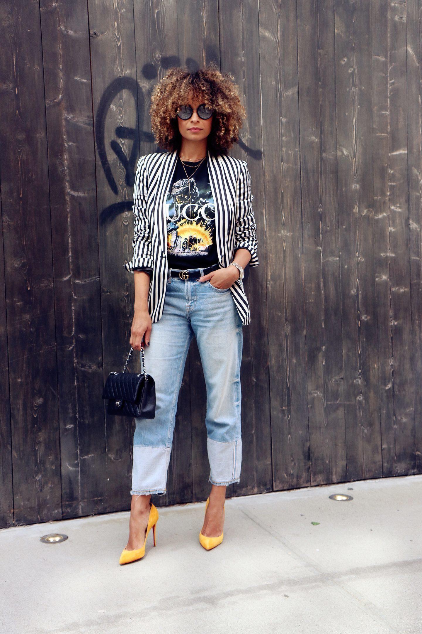 0c3bc46670f69 How to wear: white and black vertical striped blazer, black print crew-neck