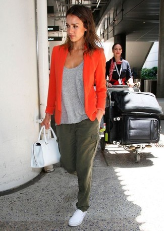 How to Wear an Orange Blazer For Women: Combining an orange blazer with olive cargo pants is a nice choice for a casually cool getup. If you wish to easily tone down this outfit with shoes, complete this getup with a pair of white slip-on sneakers.