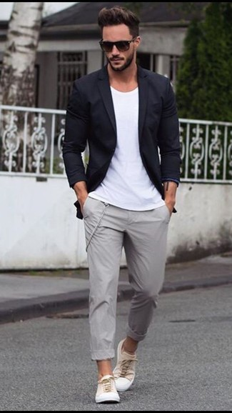 Make a jaw-dropping entry anywhere you go in a white crew-neck t-shirt and grey chino pants. A pair of white sneakers brings the dressed-down touch to the ensemble. So if it's a hot day and you want to look sharp without exerting much effort, this getup will do the job in no time.