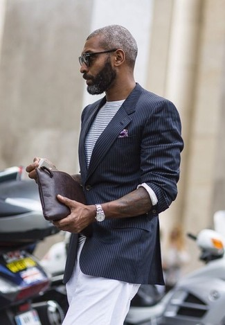 How to wear: black vertical striped blazer, white and navy horizontal striped crew-neck t-shirt, white chinos, dark brown leather zip pouch