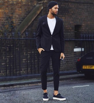 How to wear: black blazer, white crew-neck t-shirt, black chinos, black canvas low top sneakers