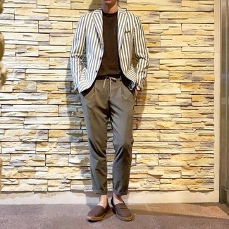 How to Wear a White and Navy Vertical Striped Blazer For Men: A white and navy vertical striped blazer and brown chinos paired together are a match made in heaven. You can take a more relaxed approach with shoes and throw in brown canvas espadrilles.
