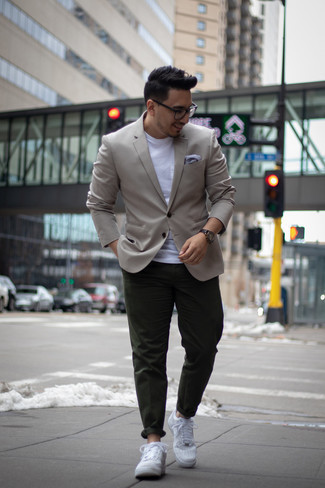 How to Wear Dark Green Chinos: Dapper up for the day in a grey blazer and dark green chinos. Balance out this outfit with more laid-back footwear, such as these white leather low top sneakers.