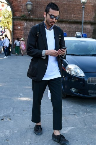 How to Wear Chinos: You'll be surprised at how easy it is for any gent to pull together this classic and casual outfit. Just a black blazer and chinos. To add a mellow feel to this getup, add black leather low top sneakers to the equation.