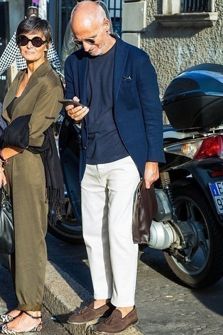 How to Wear a Navy Crew-neck T-shirt For Men: This combo of a navy crew-neck t-shirt and white chinos looks pulled together and makes any gentleman look infinitely cooler. Go off the beaten track and shake up your outfit by rocking a pair of dark brown suede tassel loafers.