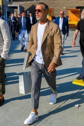 Fashion for Men Over 60: What To Wear: If the setting calls for a refined yet kick-ass ensemble, you can wear a tan blazer and grey chinos. Let your styling credentials truly shine by rounding off this ensemble with a pair of white low top sneakers.