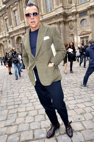 How to Wear a Black Leather Watch After 40 For Men: Marrying an olive blazer and a black leather watch will cement your prowess in men's fashion even on off-duty days. Put a different spin on an otherwise simple look by rounding off with dark purple leather monks.