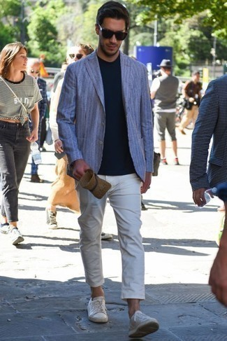 How to Wear White Leather Low Top Sneakers Casually For Men: A light blue vertical striped blazer and white chinos are the kind of a foolproof combination that you so awfully need when you have no time to craft an outfit. If you want to break out of the mold a little, rock a pair of white leather low top sneakers.