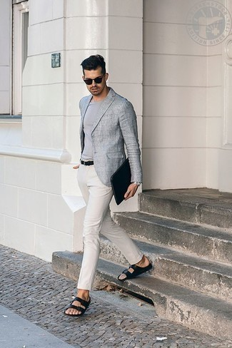 How to Wear a Black Canvas Zip Pouch For Men: Perfect the effortlessly dapper look in a grey blazer and a black canvas zip pouch. Break up this outfit with more laid-back footwear, such as this pair of black leather sandals.
