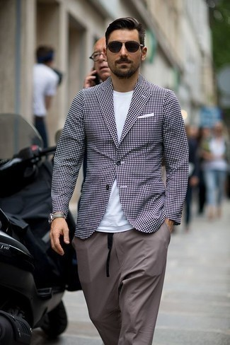 How to Wear a White Crew-neck T-shirt For Men: For comfort dressing with a fashionable spin, consider teaming a white crew-neck t-shirt with grey chinos. This combination should clear any doubts you had about dressing casually in your 30s.