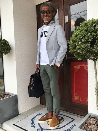 Light Blue Blazer Outfits For Men: This combo of a light blue blazer and dark green chinos is a safe bet when you need to look casually neat but have zero time to spare. Inject a more relaxed twist into this ensemble by rounding off with tan suede slip-on sneakers.