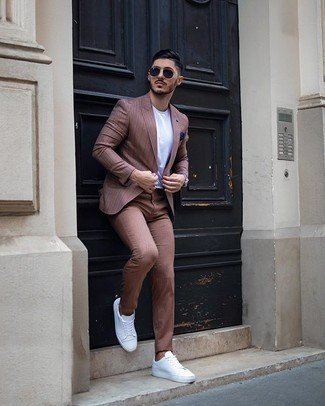 Navy Sunglasses Outfits For Men: This pairing of a brown vertical striped blazer and navy sunglasses is outrageously dapper and yet it's comfortable and ready for anything. Get a little creative in the shoe department and spruce up your look by rocking a pair of white canvas low top sneakers.