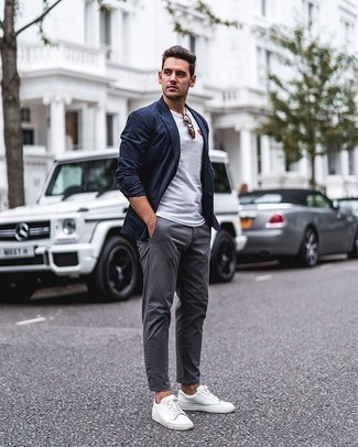 White Print Crew-neck T-shirt Outfits For Men: Want to infuse your closet with some effortless dapperness? Consider wearing a white print crew-neck t-shirt and grey chinos. If in doubt as to what to wear on the footwear front, stick to a pair of white canvas low top sneakers.