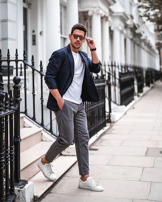 White Print Crew-neck T-shirt Outfits For Men: This combo of a white print crew-neck t-shirt and grey chinos is very versatile and apt for whatever's on your errand list today. If not sure about the footwear, go with a pair of white canvas low top sneakers.