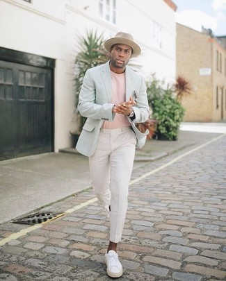 Light Blue Blazer Outfits For Men: For an outfit that's worthy of a modern style-savvy gent and effortlessly polished, rock a light blue blazer with white chinos. Bump up the appeal of this look by rounding off with a pair of white canvas low top sneakers.
