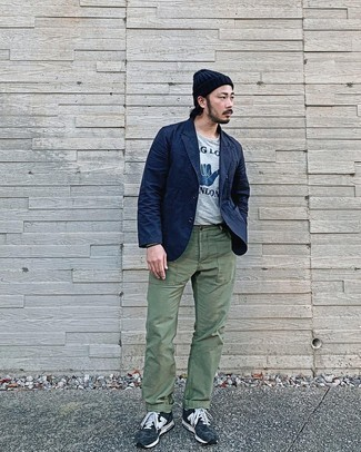 Grey Print Crew-neck T-shirt Outfits For Men: This relaxed casual pairing of a grey print crew-neck t-shirt and olive chinos comes to rescue when you need to look dapper in a flash. A great pair of navy and white athletic shoes is a simple way to give a hint of stylish effortlessness to your getup.