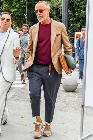 Tobacco Leather Zip Pouch Outfits For Men: This pairing of a tan blazer and a tobacco leather zip pouch is on the off-duty side yet it's also on-trend and extra stylish. When not sure about the footwear, stick to tan athletic shoes.