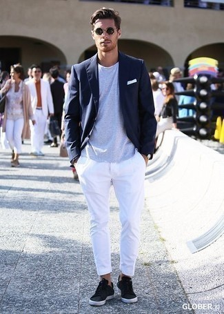 Jacket Outfits For Men: Team a jacket with white chinos if you're aiming for a clean, dapper ensemble. A trendy pair of black leather low top sneakers is an effective way to inject a hint of stylish nonchalance into this look.