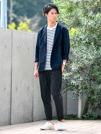 White Leather Low Top Sneakers Outfits For Men: Combining a navy blazer with black chinos is an on-point choice for a casually sleek ensemble. Have some fun with things and throw a pair of white leather low top sneakers into the mix.