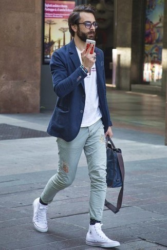 Bracelet Outfits For Men: A navy blazer and a bracelet are a good combo to incorporate into your day-to-day off-duty arsenal. Let your styling expertise really shine by finishing off this look with white canvas high top sneakers.