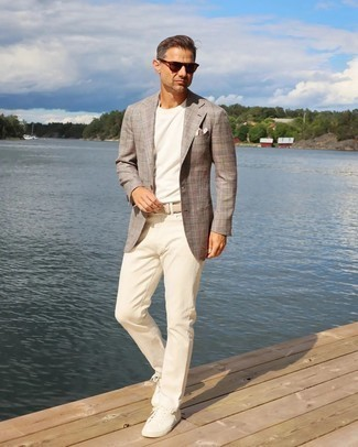 1200+ Outfits For Men After 40: This pairing of a brown plaid blazer and beige chinos is indisputable proof that a simple outfit doesn't have to be boring. Inject a mellow feel into this look by finishing off with white canvas low top sneakers. Like this style idea for a mature gent?
