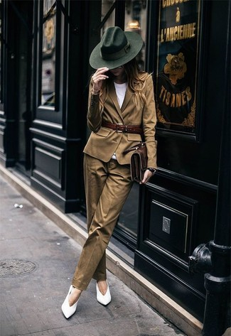 Brown Blazer Outfits For Women: This combination of a brown blazer and brown dress pants is extremely easy to throw together without a second thought, helping you look chic and prepared for anything without spending a ton of time digging through your wardrobe. White leather pumps pull the outfit together.