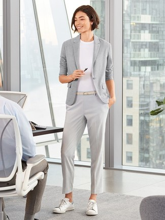If you're on the hunt for a casual yet absolutely chic getup, go for a grey knit blazer and grey dress pants. Both pieces are totally comfy and will look fabulous together. A pair of white leather low top sneakers ads edginess to a femme classic. It goes without saying that this one makes for a great, spring-friendly combination.